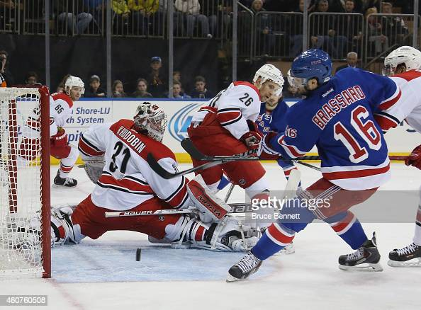 Derick Brassard of the New York Rangers misses a second period chance against Anton Khudobin of the Carolina Hurricanes at Madison Square Garden on...