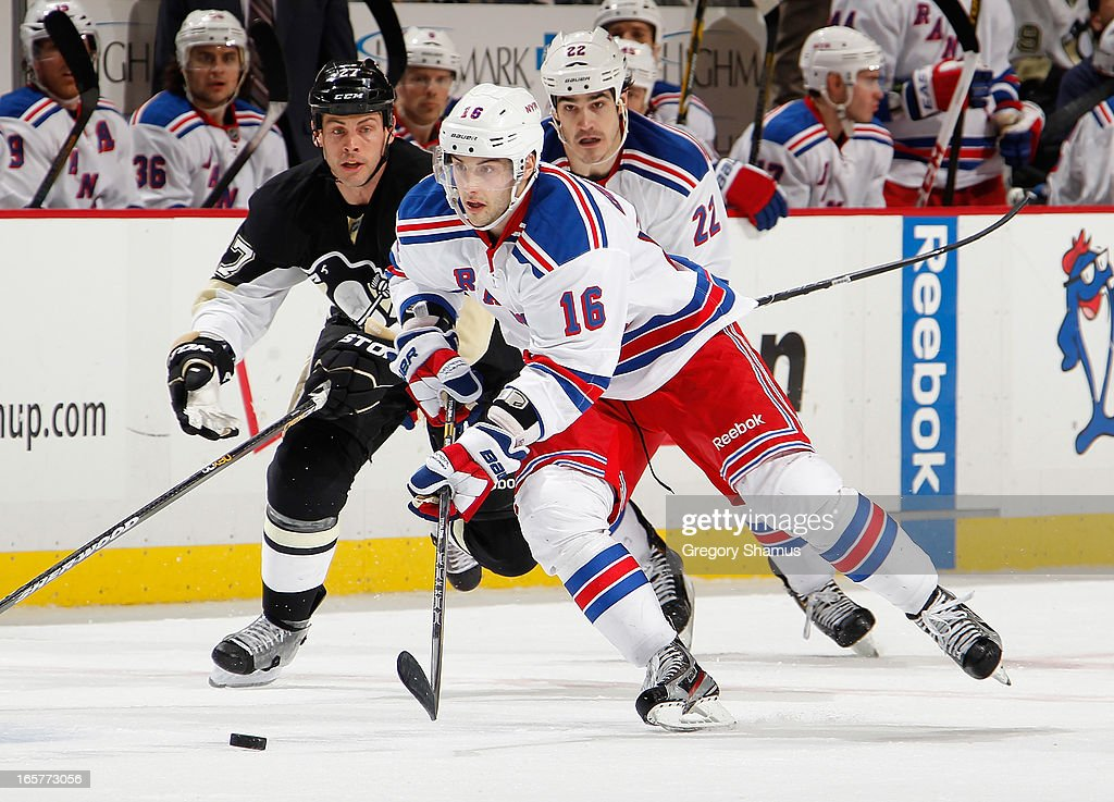 <a gi-track='captionPersonalityLinkClicked' href=/galleries/search?phrase=Derick+Brassard&family=editorial&specificpeople=540468 ng-click='$event.stopPropagation()'>Derick Brassard</a> #16 of the New York Rangers moves the puck up ice in front of <a gi-track='captionPersonalityLinkClicked' href=/galleries/search?phrase=Craig+Adams&family=editorial&specificpeople=211144 ng-click='$event.stopPropagation()'>Craig Adams</a> #27 of the Pittsburgh Penguins on April 5, 2013 at Consol Energy Center in Pittsburgh, Pennsylvania. Pittsburgh won the game 2-1 in a shootout.