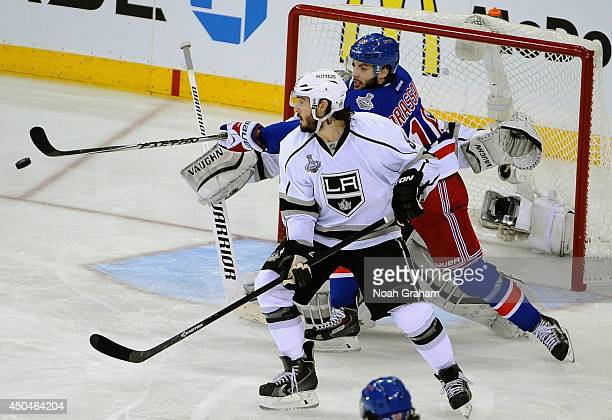 Derick Brassard of the New York Rangers reaches for the puck behind Drew Doughty of the Los Angeles Kings in the third period of Game Four of the...