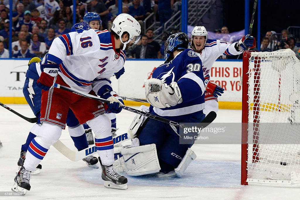 Derick Brassard of the New York Rangers scores a goal against Ben Bishop of the Tampa Bay Lightning during the first period in Game Six of the...