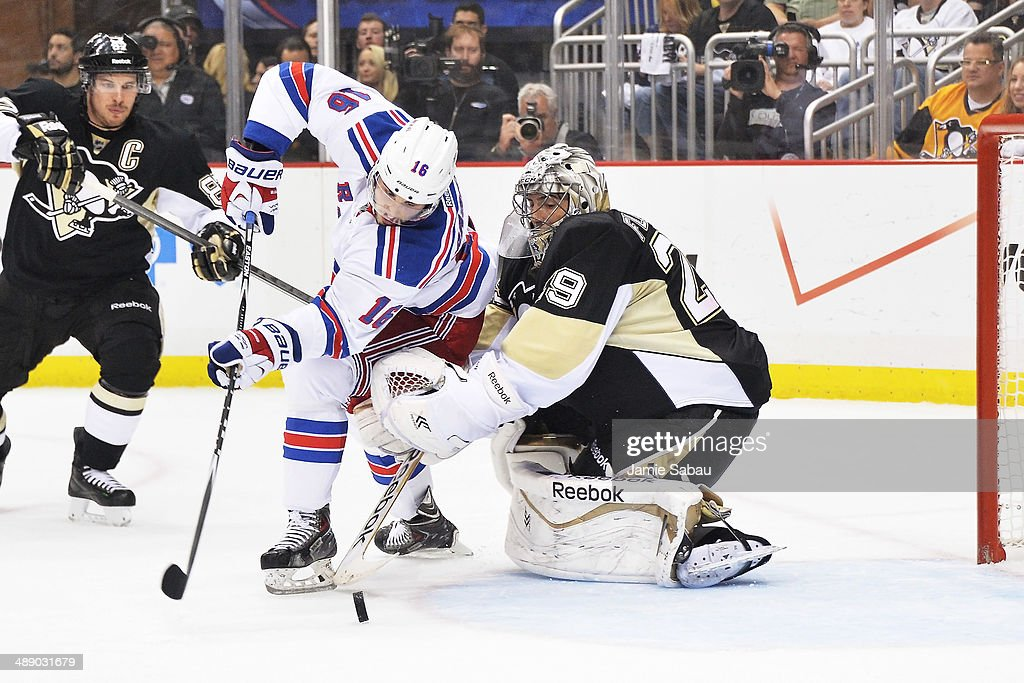 Derick Brassard #16 of the New York Rangers scores a goal on goaltender Marc-Andre Fleury #29 of the Pittsburgh Penguins in the first period in Game Five of the Second Round of the 2014 NHL Stanley Cup Playoffs on May 9, 2014 at CONSOL Energy Center in Pittsburgh, Pennsylvania.