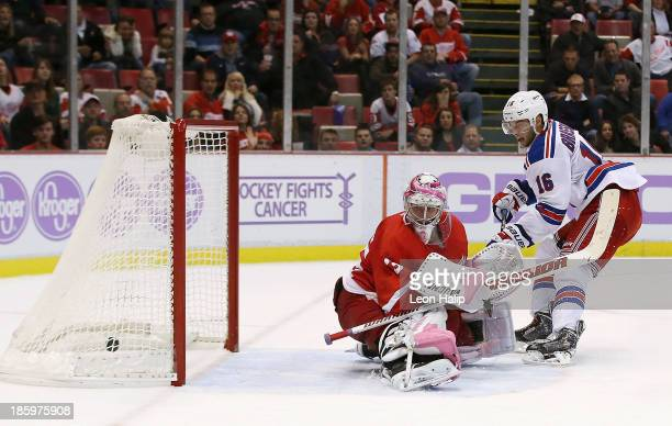 Derick Brassard of the New York Rangers scores the game winner goal in overtime againat golie Jimmy Howard of the Detroit Red Wings at Joe Louis...