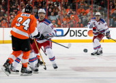 Derick Brassard of the New York Rangers shoots the puck against Matt Read of the Philadelphia Flyers in Game Six of the First Round of the 2014...