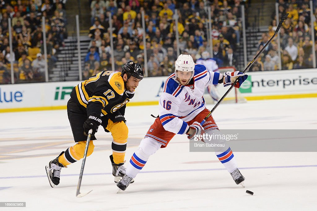 Derick Brassard #16 of the New York Rangers shoots the puck against Milan Lucic #17 of the Boston Bruins in Game Five of the Eastern Conference Semifinals during the 2013 NHL Stanley Cup Playoffs at TD Garden on May 25, 2013 in Boston, Massachusetts.