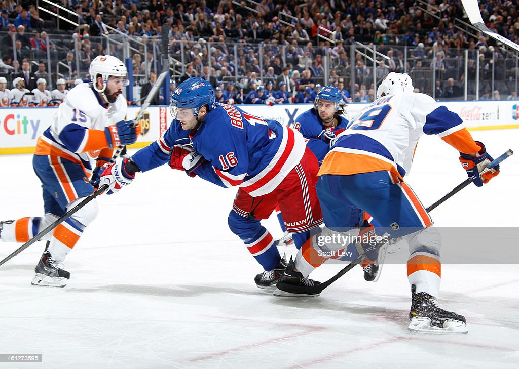 <a gi-track='captionPersonalityLinkClicked' href=/galleries/search?phrase=Derick+Brassard&family=editorial&specificpeople=540468 ng-click='$event.stopPropagation()'>Derick Brassard</a> #16 of the New York Rangers skates against the New York Islanders at Madison Square Garden on January 21, 2014 in New York City.