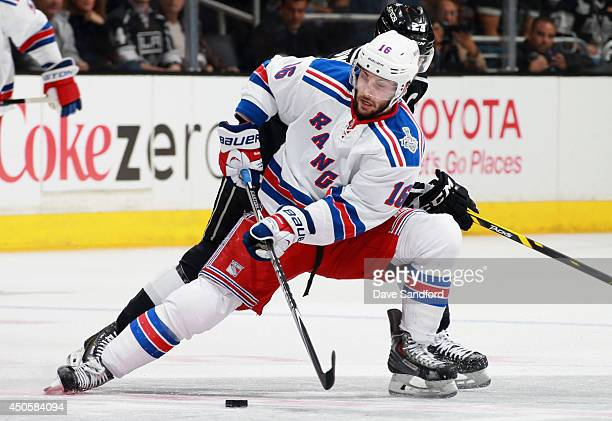 Derick Brassard of the New York Rangers tries to get control of the puck away from Dustin Brown of the Los Angeles Kings in the third period of Game...