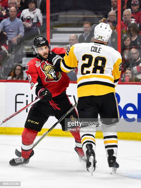 Derick Brassard of the Ottawa Senators and Ian Cole of the Pittsburgh Penguins push each other in Game Six of the Eastern Conference Final during the...