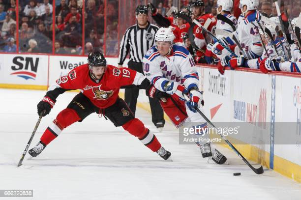 Derick Brassard of the Ottawa Senators backchecks as JT Miller of the New York Rangers stickhandles the puck at the blue line at Canadian Tire Centre...