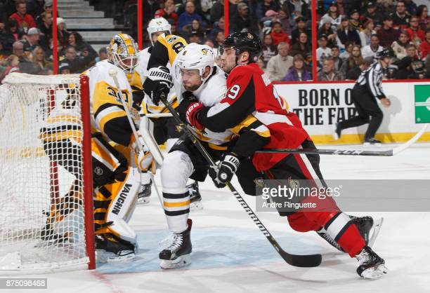 Derick Brassard of the Ottawa Senators battles for position against Brian Dumoulin of the Pittsburgh Penguins in front of Matt Murray at Canadian...