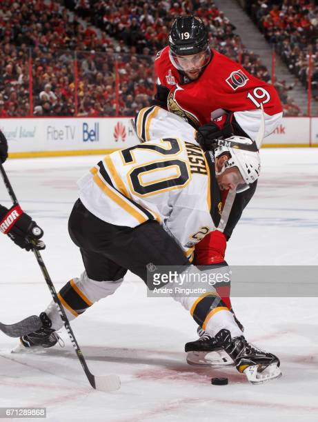 Derick Brassard of the Ottawa Senators battles on the faceoff against Riley Nash of the Boston Bruins in Game Five of the Eastern Conference First...