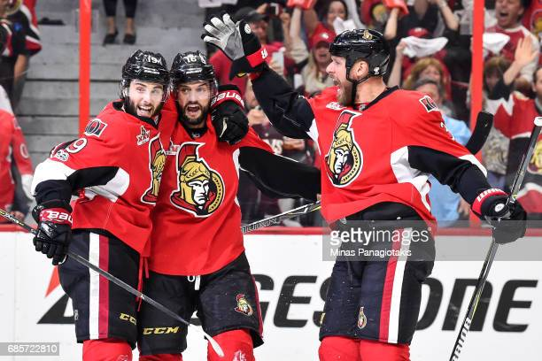 Derick Brassard of the Ottawa Senators celebrates a first period goal with teammates Clarke MacArthur and Marc Methot against the Pittsburgh Penguins...