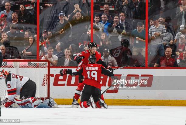 Derick Brassard of the Ottawa Senators celebrates his second period goal against the New Jersey Devils with teammate Mark Stone at Canadian Tire...