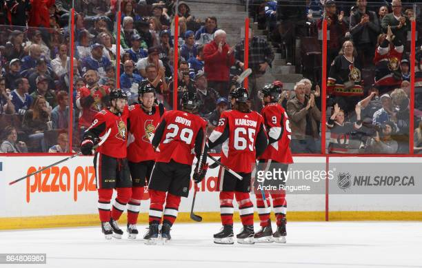 Derick Brassard of the Ottawa Senators celebrates his second period goal against the Toronto Maple Leafs with teammates Mark Stone Johnny Oduya Erik...