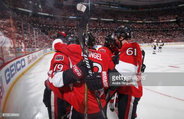 Derick Brassard of the Ottawa Senators celebrates his third period goal against the Boston Bruins with teammates Ryan Dzingel and Mark Stone in Game...