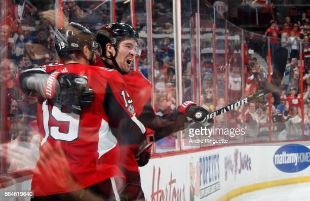 Derick Brassard of the Ottawa Senators celebrates his third period goal against the Toronto Maple Leafs with teammate Mark Stone at Canadian Tire...