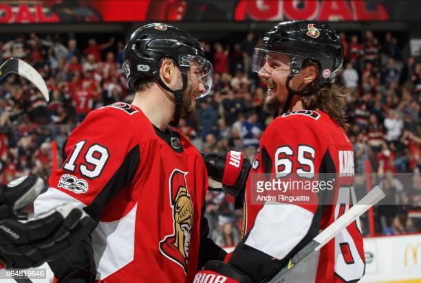 Derick Brassard of the Ottawa Senators celebrates his third period goal against the Toronto Maple Leafs with teammate Erik Karlsson at Canadian Tire...