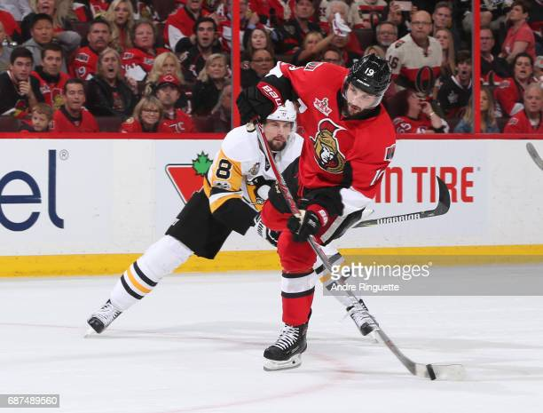 Derick Brassard of the Ottawa Senators fires a shot with Brian Dumoulin of the Pittsburgh Penguins chasing in Game Six of the Eastern Conference...