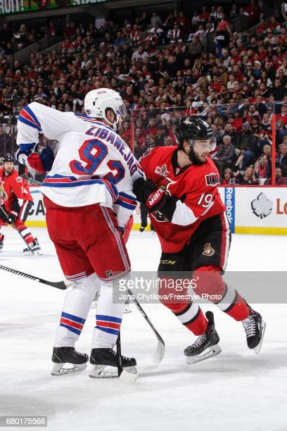 Derick Brassard of the Ottawa Senators grabs the jersey of Mika Zibanejad of the New York Rangers following a faceoff in Game Five of the Eastern...