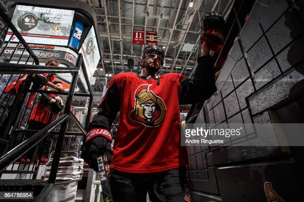 Derick Brassard of the Ottawa Senators highfives a fan as he leaves the ice after warmup prior to a game against the Toronto Maple Leafs at Canadian...