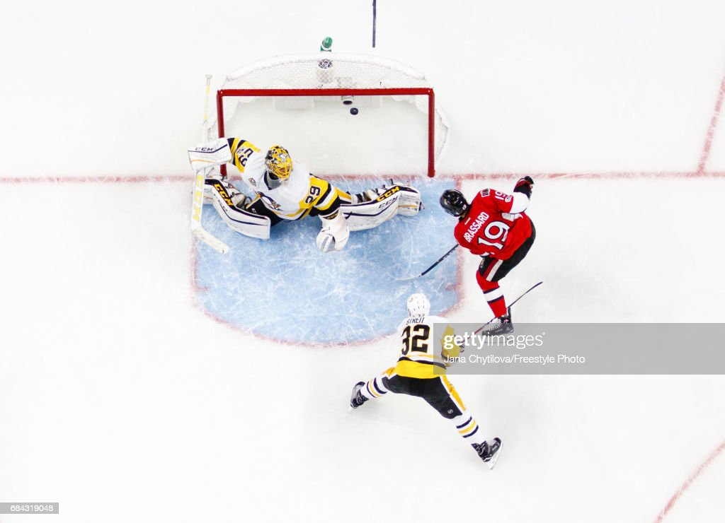 Derick Brassard #19 of the Ottawa Senators scores a first period goal against Marc-Andre Fleury #29 of the Pittsburgh Penguins as Mark Streit #32 of the Pittsburgh Penguins looks on in Game Three of the Eastern Conference Final during the 2017 NHL Stanley Cup Playoffs at Canadian Tire Centre on May 17, 2017 in Ottawa, Ontario, Canada.