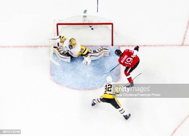 Derick Brassard of the Ottawa Senators scores a first period goal against MarcAndre Fleury of the Pittsburgh Penguins as Mark Streit of the...