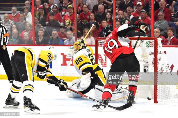 Derick Brassard of the Ottawa Senators scores a goal against MarcAndre Fleury of the Pittsburgh Penguins during the first period in Game Three of the...