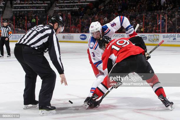 Derick Brassard of the Ottawa Senators take a faceoff against Mika Zibanejad of the New York Rangers at Canadian Tire Centre on April 8 2017 in...