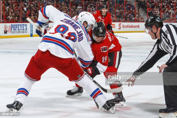Derick Brassard of the Ottawa Senators takes a faceoff against Mika Zibanejad of the New York Rangers in Game Five of the Eastern Conference Second...