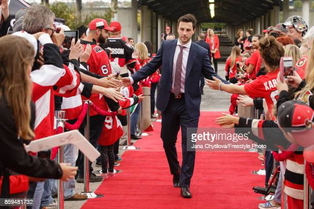 Derick Brassard of the Ottawa Senators walks the red carpet prior to the start of a game against the Detroit Red Wings at Canadian Tire Centre on...