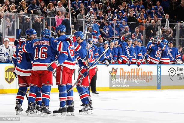 Derick Brassard Rick Nash and Dan Girardi of the New York Rangers celebrate after a late third period goal against the Toronto Maple Leafs at Madison...