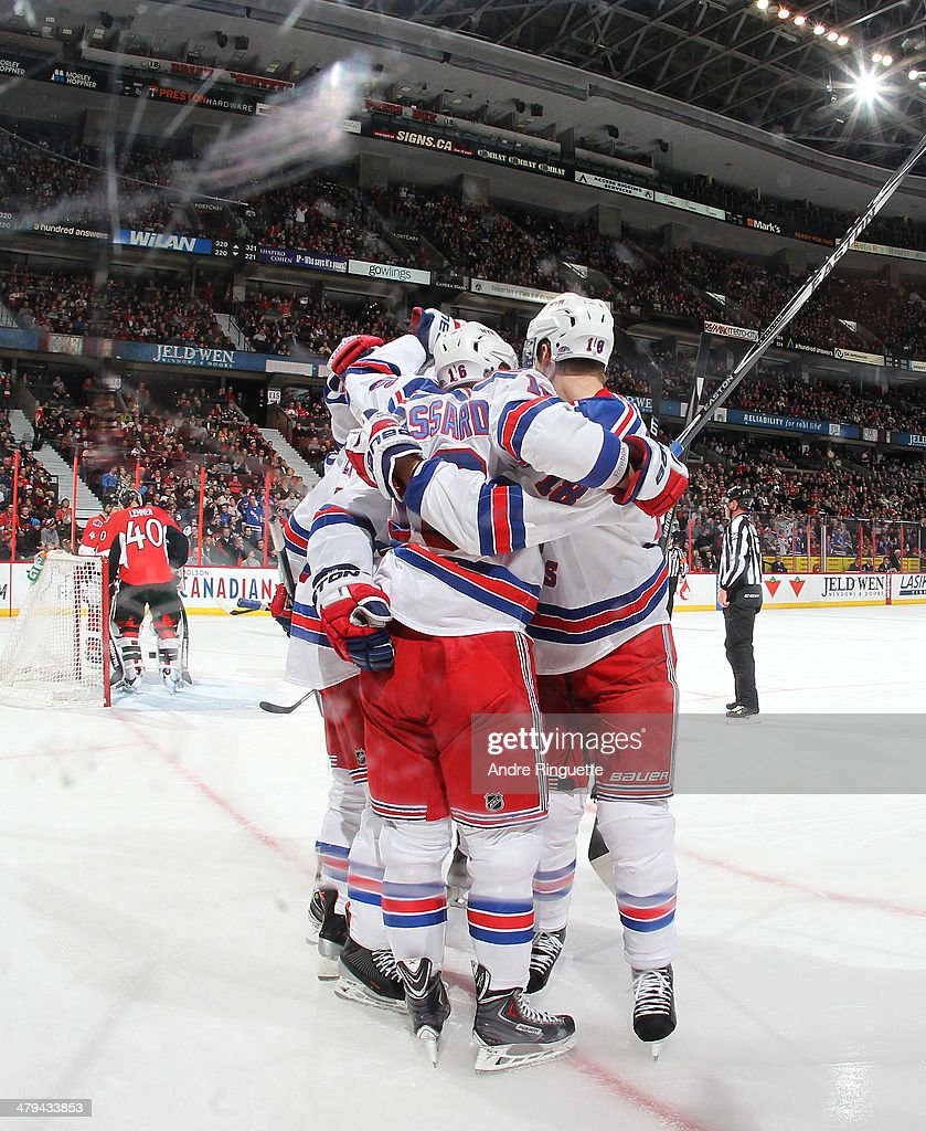 <a gi-track='captionPersonalityLinkClicked' href=/galleries/search?phrase=Derick+Brassard&family=editorial&specificpeople=540468 ng-click='$event.stopPropagation()'>Derick Brassard</a> #16 the New York Rangers celebrates his second period goal against <a gi-track='captionPersonalityLinkClicked' href=/galleries/search?phrase=Robin+Lehner&family=editorial&specificpeople=5894610 ng-click='$event.stopPropagation()'>Robin Lehner</a> #40 of the Ottawa Senators with teammates at Canadian Tire Centre on March 18, 2014 in Ottawa, Ontario, Canada.