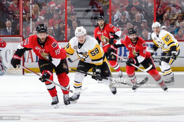 Derick Brassard Tom Pyatt and Erik Karlsson of the Ottawa Senators skate against Jake Guentzel and Sidney Crosby of the Pittsburgh Penguins in Game...
