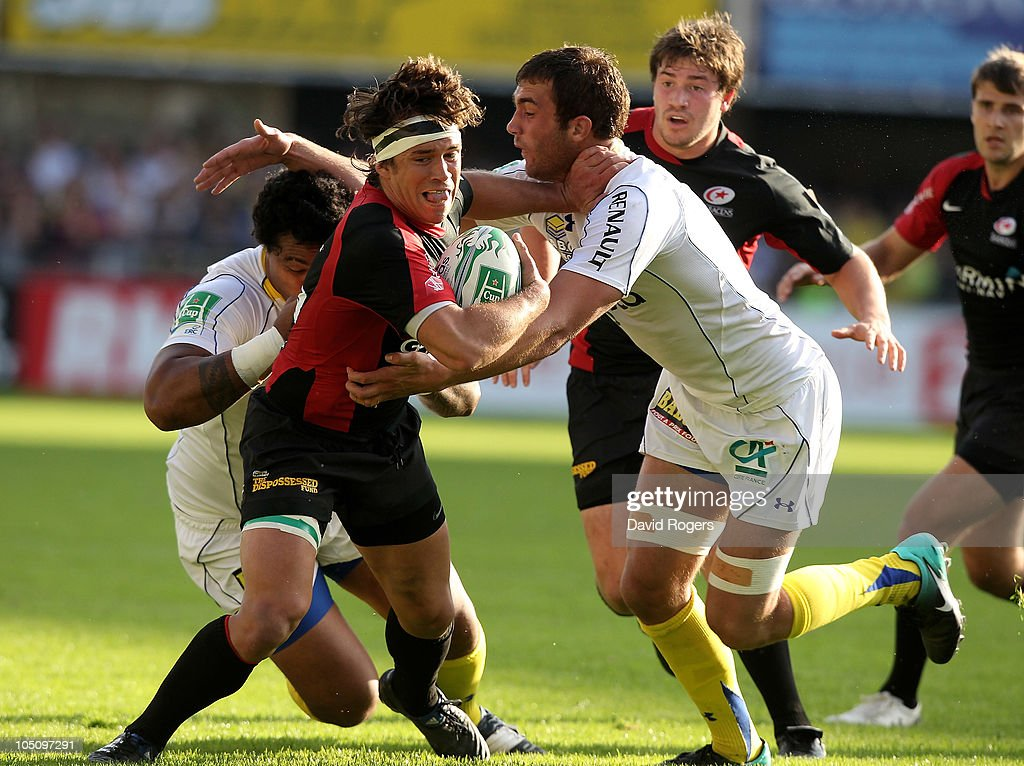 Derick Hougaard of Saracens is tackled by <a gi-track='captionPersonalityLinkClicked' href=/galleries/search?phrase=Alexandre+Lapandry&family=editorial&specificpeople=5678412 ng-click='$event.stopPropagation()'>Alexandre Lapandry</a> (R) and <a gi-track='captionPersonalityLinkClicked' href=/galleries/search?phrase=Napolioni+Nalaga&family=editorial&specificpeople=4067717 ng-click='$event.stopPropagation()'>Napolioni Nalaga</a> during the Heineken Cup match between ASM Clermont Auvergne and Saracens at Stade Marcel Michelin on October 9, 2010 in Clermont Ferrand, France.
