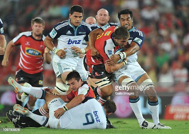 Derick Minnie of the Lions is tackled during the Super Rugby match between Lions and Blues at Coca Cola Park on March 04 2011 in Johannesburg South...