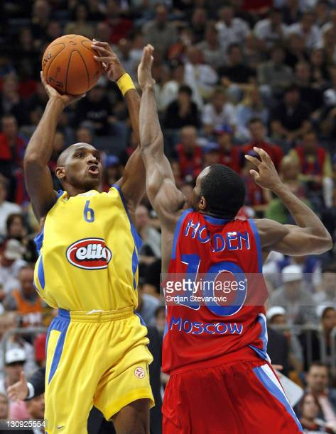 Derick Sharp of Maccabi Tel Aviv scores over Jon Robert holden of CSKA Moscow during a NBA Live Tour friendly basketball match between CSKA Moscow...
