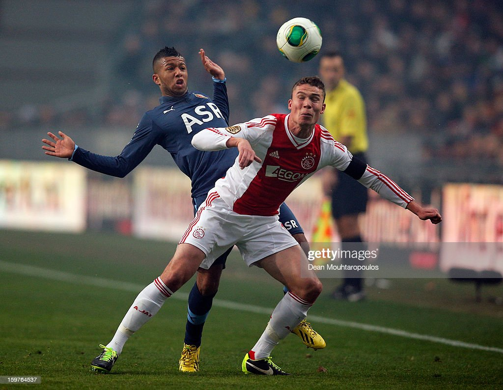 <a gi-track='captionPersonalityLinkClicked' href=/galleries/search?phrase=Derk+Boerrigter&family=editorial&specificpeople=8003354 ng-click='$event.stopPropagation()'>Derk Boerrigter</a> of Ajax and Tonny Vilhena of Feyenoord battle for the ball during the Eredivisie match between Ajax Amsterdam and Feyenoord Rotterdam at Amsterdam Arena on January 20, 2013 in Amsterdam, Netherlands.