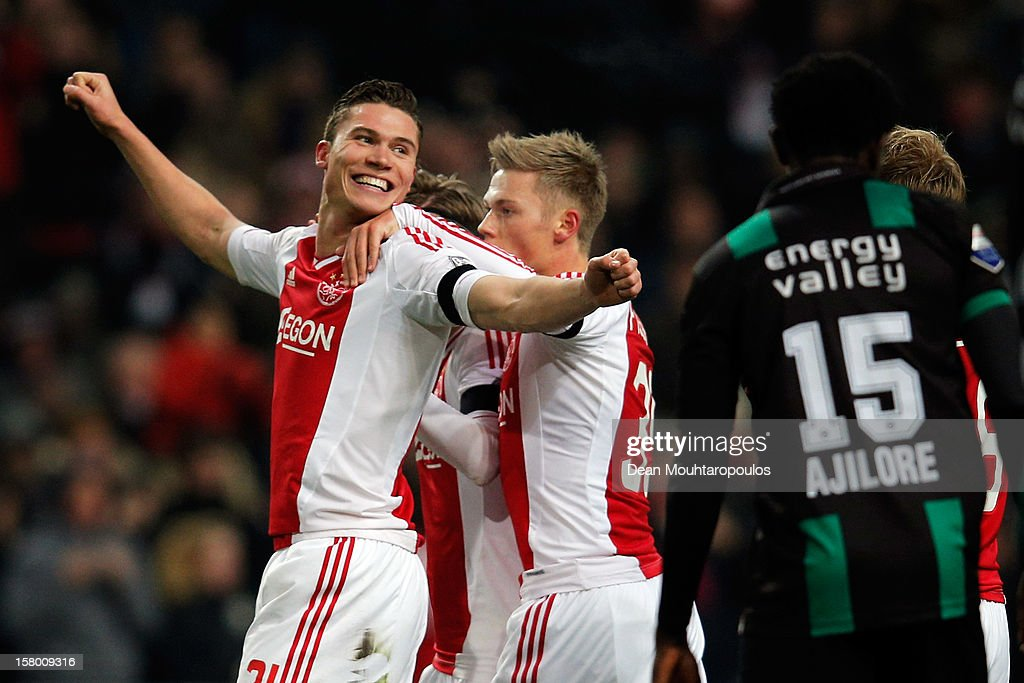 <a gi-track='captionPersonalityLinkClicked' href=/galleries/search?phrase=Derk+Boerrigter&family=editorial&specificpeople=8003354 ng-click='$event.stopPropagation()'>Derk Boerrigter</a> of Ajax celebrates with team mates after he scores the first goal of the game during the Eredivisie match between Ajax Amsterdam and FC Groningen at Amsterdam Arena on December 8, 2012 in Amsterdam, Netherlands.
