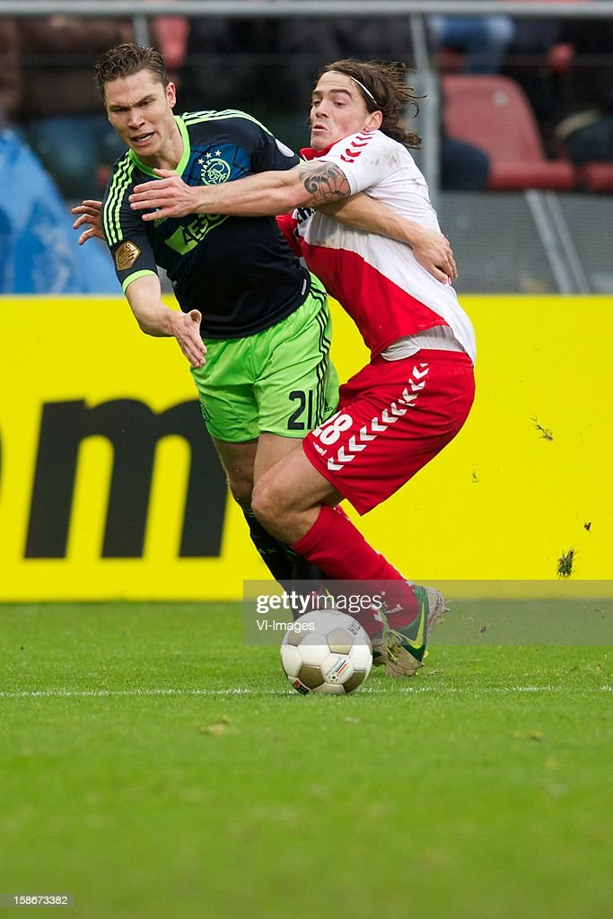 Derk Boerrigter of Ajax, Dave Bulthuis of FC Utrecht during the Dutch Eredivise match between FC Utrecht and Ajax Amsterdam at the Galgenwaard on December 23, 2012 in Utrecht, The Netherlands.