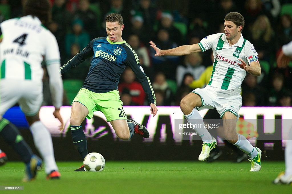 Derk Boerrigter of Ajax, Kees Kwakman of FC Groningen during the Dutch Cup match between FC Groningen and Ajax Amsterdam at the Euroborg on December 20, 2012 in Groningen, The Netherlands.
