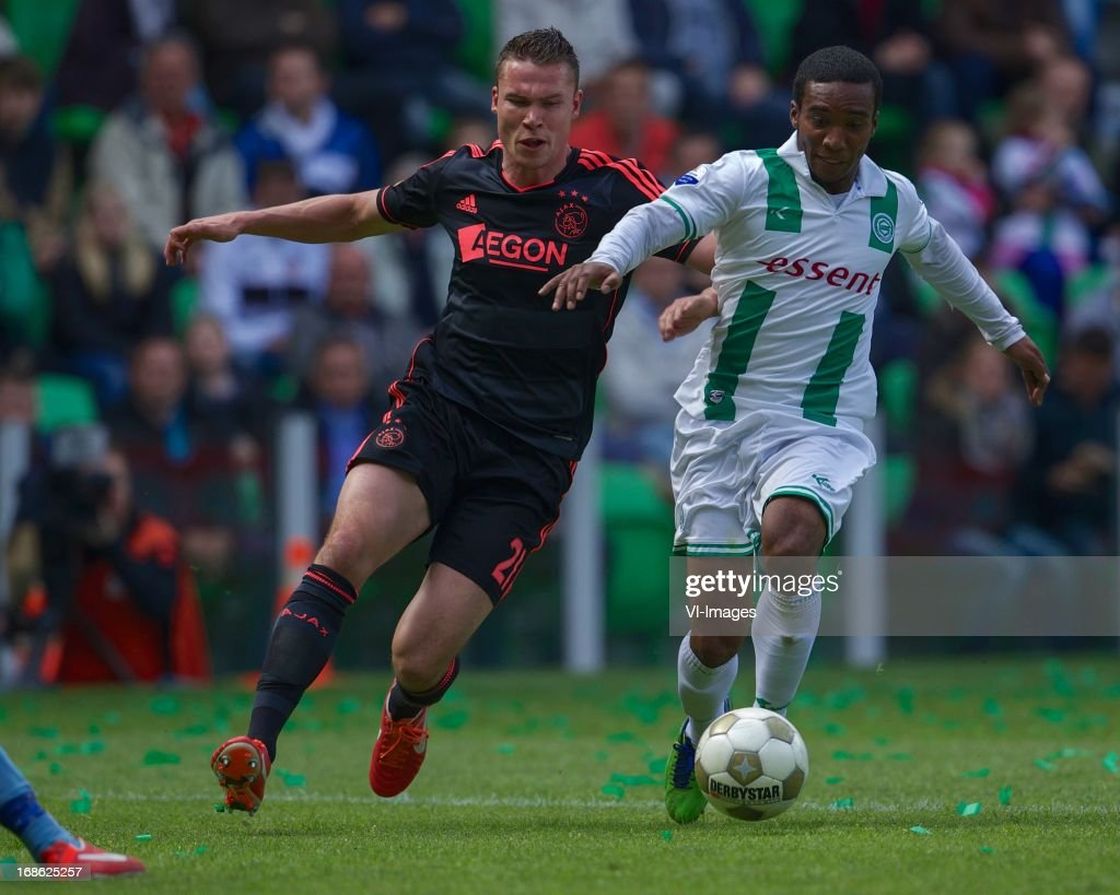 Derk Boerrigter of Ajax, Lorenzo Burnet of FC Groningen during the Dutch Eredivisie match between FC Groningen and Ajax on May 12, 2013 at the Euroborg stadium in Groningen, The Netherlands.
