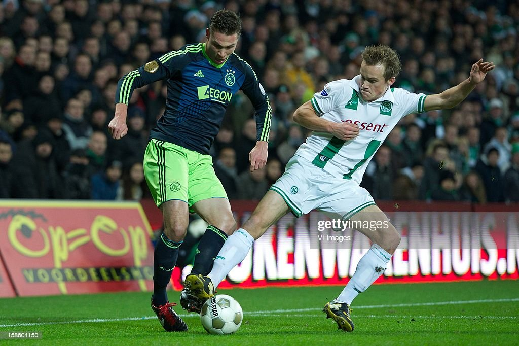Derk Boerrigter of Ajax, Maikel Kieftenbeld of FC Groningen during the Dutch Cup match between FC Groningen and Ajax Amsterdam at the Euroborg on December 20, 2012 in Groningen, The Netherlands.