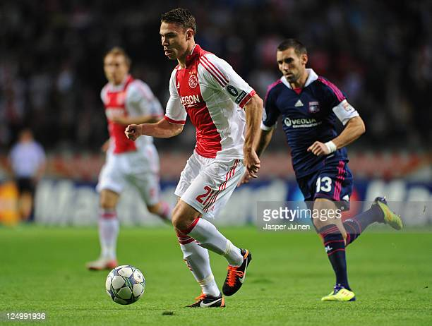 Derk Boerrigter of Ajax runs for the ball with Anthony Reveillere of Olympique Lyonnais during the UEFA Champions League group D match between AFC...