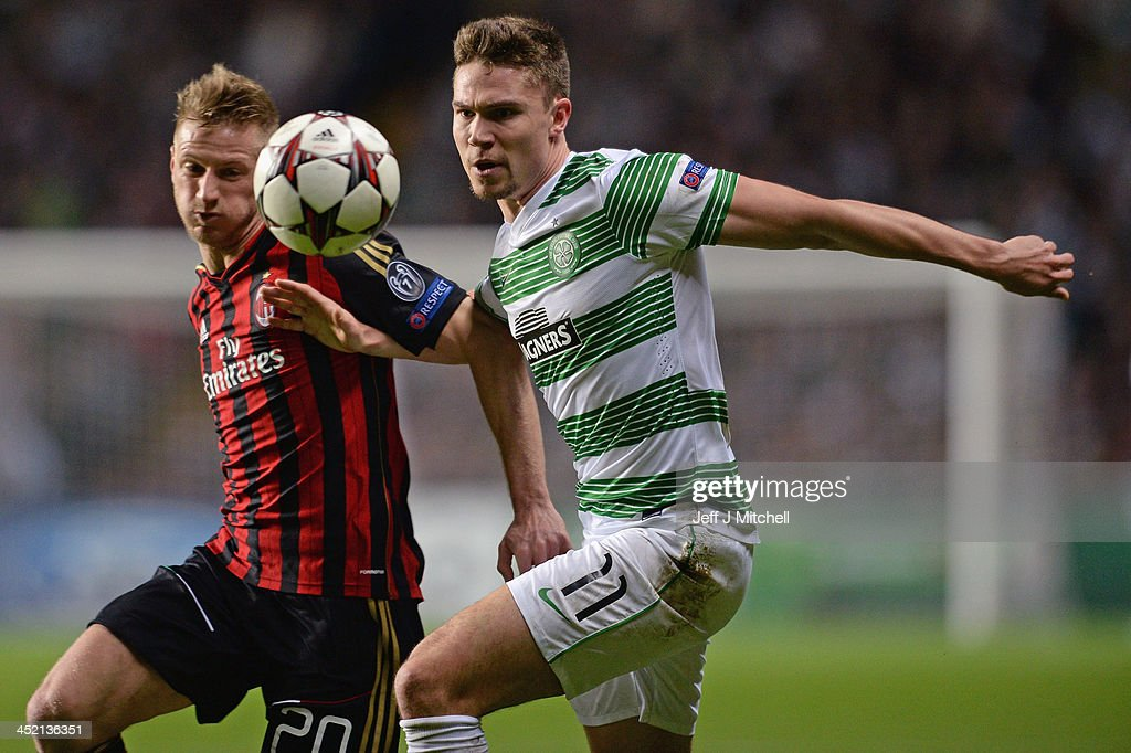 <a gi-track='captionPersonalityLinkClicked' href=/galleries/search?phrase=Derk+Boerrigter&family=editorial&specificpeople=8003354 ng-click='$event.stopPropagation()'>Derk Boerrigter</a> of Celtic is tackled by <a gi-track='captionPersonalityLinkClicked' href=/galleries/search?phrase=Christian+Abbiati&family=editorial&specificpeople=2158791 ng-click='$event.stopPropagation()'>Christian Abbiati</a> of AC Milan during the UEFA Champions League Group H match between Celtic and AC Milan at Celtic Park Stadium on November 26, 2013 in Glasgow, Scotland.