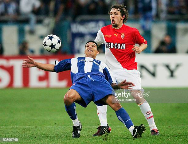 Derlei of FC Porto battles with Gael Givet of AS Monaco during the UEFA Champions League Final match between AS Monaco and FC Porto at the AufSchake...