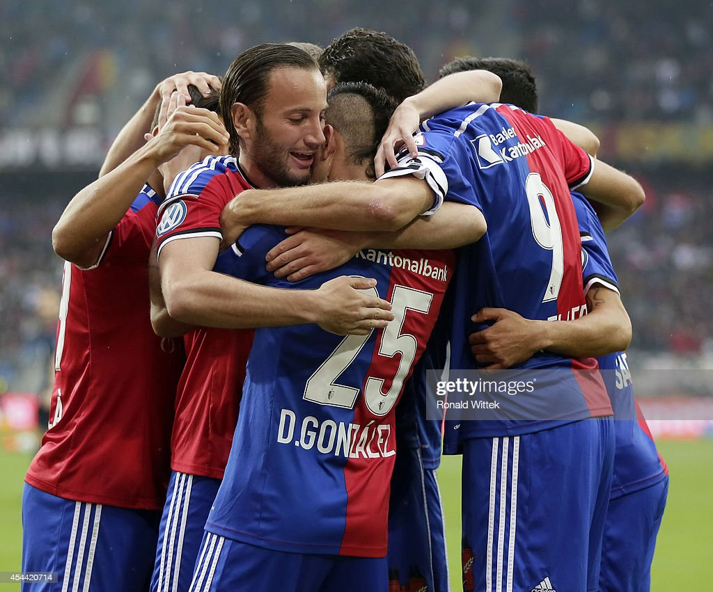 Derlis Gonzalez of Basel celebrates with team-mates after scoring his team's first goal during the Raiffeisen Super League match between FC Basel and BSC Young Boys Bern at St.Jakob-Park on August 31, 2014 in Basel, Switzerland.