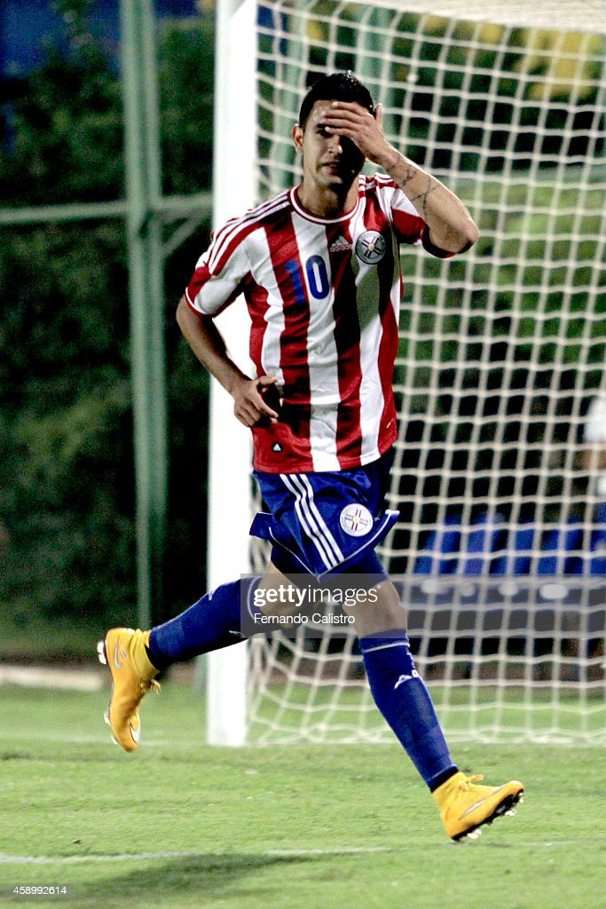 Derlis Gonzalez of Paraguay celebrates after scoring the second goal of his team during an international friendly match between Paraguay and Peru at Feliciano Caceres Stadium on November 14, 2014 in Luque, Paraguay.
