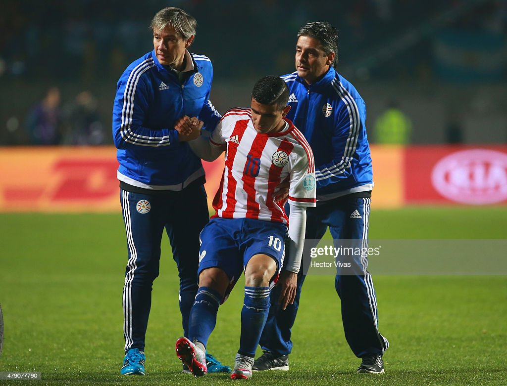 Derlis Gonzalez of Paraguay (C) leaves the field after being injuried during the 2015 Copa America Chile Semi Final match between Argentina and Paraguay at Ester Roa Rebolledo Stadium on June 30, 2015 in Concepcion, Chile.