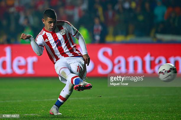 Derlis Gonzalez of Paraguay shoots to score the fifth penalty kick in the penalty shootout during the 2015 Copa America Chile quarter final match...