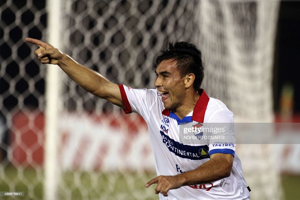 Derlis Orue of Paraguay's Nacional celebrates after scoring against Argentina's Arsenal during their Copa Libertadores football match at Defensores...