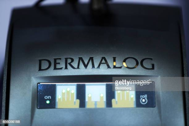 A Dermalog logo sits on an LF10 biometric fingerprint scanner at the Dermalog Identification Systems GmbH pavilion at the CeBIT 2017 tech fair in...